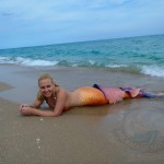 mermaid melissa on beach with new orange tail