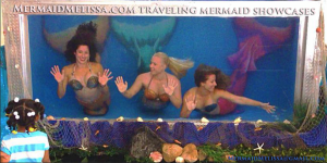 Underwater performers live acts in traveling tanks by Mermaid Melissa